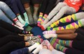 Circle of student's feet wearing crazy socks.