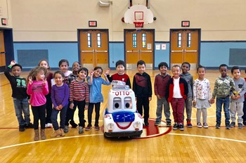 Students with a remote controlled car