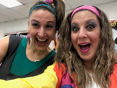 Two teachers dressed in 1980s clothes style
