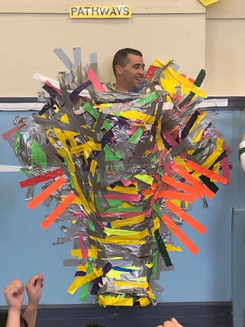 A Principal Duct Taped to a Wall