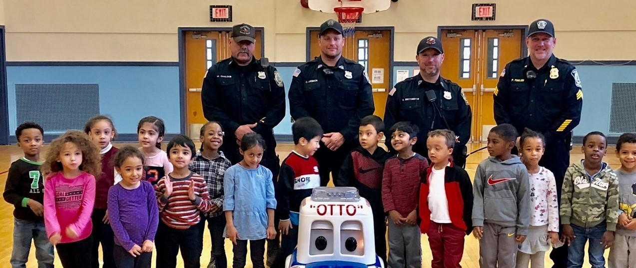 Students and Police Officers with a remote control car