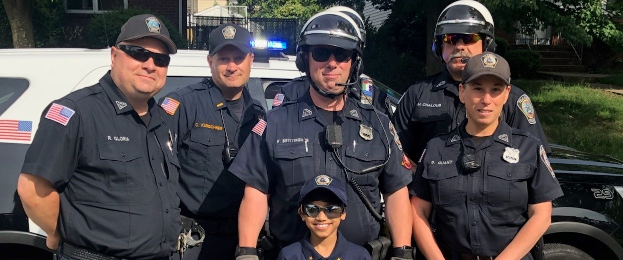 Student Standing with Police Officers