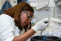 Chanelle Case Borden, Ph.D (female scientist) working in a National Cancer Institute DNA lab.